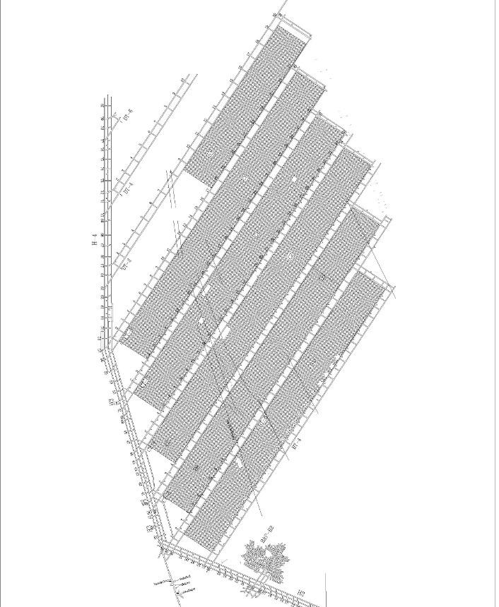 Hovedstollen begrenser gruven mot vest. Produksjonspanelene er orientert nordøst-sørvest, og med sort farge ser vi de som allerede er tømt for kull. Mellom panelene ser vi de 6 m høye og 4 m brede oppfaringstollene. I løpet av ett år drives hele ti km med slike gruveganger.  Illustrasjon: Store Norske